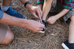 High angle view of father tying shoelace for son Royalty Free Stock Photo