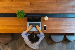 High angle view of female typing laptop computer stock photos