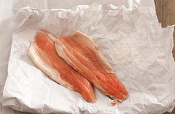 High angle view of fish fillets on white paper Stock Image