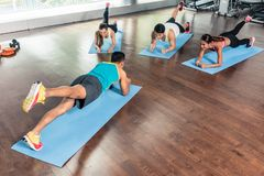 High-angle view of a fitness instructor during group calisthenics stock photography