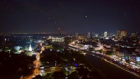 Floating lanterns and People in Yee Peng or Loy Krathong Festival. High angle view of Floating lanterns firework and people in Yee Peng or Loy Krathong Festival stock video footage