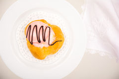 High angle view of a French pastry. On white plate and background Stock Photo