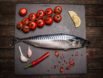 High Angle View of Fresh Raw Whole Fish on Slate Cutting Board S Royalty Free Stock Photos
