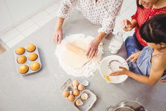 High angle view of girl helping family in preparing food Stock Photos