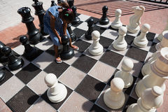 High angle view of girl playing with chess pieces Royalty Free Stock Photos