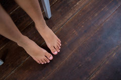 High angle view of girl sitting on chair over hardwood floor. At home stock photo
