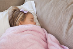 High angle view of a girl sleeping on sofa Royalty Free Stock Images