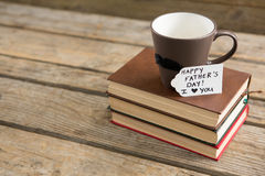 High angle view of greetings with coffee cup and books Royalty Free Stock Photo