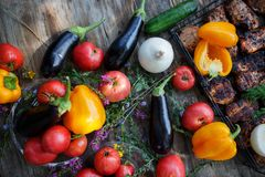 Vegetables, fish, meat and ingredients for cooking. Tomatoes, pepper, corn, beef. Top view on stone table. stock photos