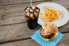 High angle view of hamburger with drink and french fries. On table Stock Image