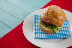 High angle view of hamburger served on napkin in plate. At table Stock Photo