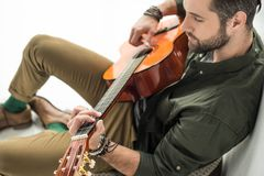 high angle view of handsome musician playing stock photo