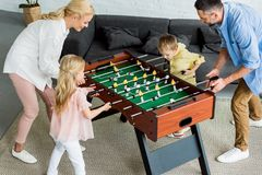high angle view of happy family with two kids playing table football together royalty free stock photos