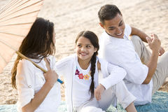 High angle view of happy Hispanic family on beach royalty free stock image