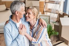 high angle view of happy senior couple embracing holding hands and smiling each other stock photography