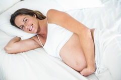 High angle view of happy woman on bed Stock Photography