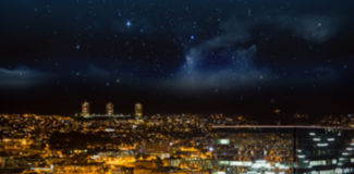 High angle view of illuminated crowded cityscape. At night Stock Images