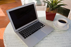 High angle view of laptop by coffee cup and potted plant Royalty Free Stock Photo
