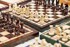 Chess Boards. High angle view of a large amount of homemade chess boards displayed for sale on a table at a flea market Stock Images