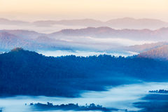 High angle view of layer tropical mountains with white fog Royalty Free Stock Photos