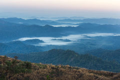 High angle view of layer tropical mountains with white fog Royalty Free Stock Photo