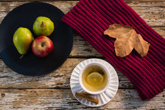High angle view of lemon tea by fruits in plate. On wooden table Stock Image