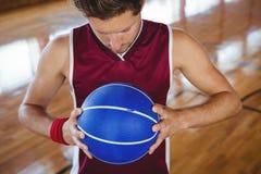 High angle view of male basketball player holding ball Stock Photos