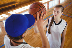 High angle view of male coach training female basketball player Royalty Free Stock Photo