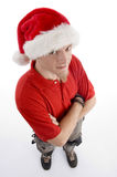 High angle view of male wearing christmas hat. With white background Stock Photography