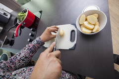 High angle view of man cutting potato at kitchen counter Stock Photos