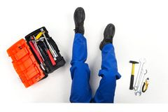 High angle view of man laying and fixing. Royalty Free Stock Image