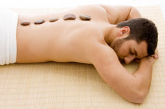 High angle view of man lying down on mat at spa Stock Images