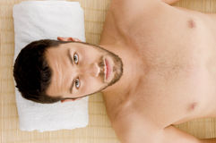 High angle view of man receiving hot stone massage Stock Photo