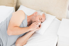 High angle view of a man suffering from cold in bed Stock Images