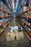 High angle view of managers are looking up and pointing shelves Stock Photo