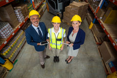 High angle view of managers and worker wearing hard hat and looking the camera Royalty Free Stock Image