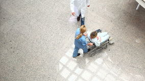 High angle view of a medical team wheeling a patient in a wheelchair Stock Images