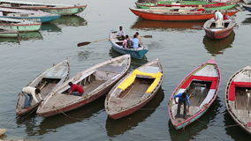 High angle view of men on boats preparing to sail in bay of Ganges river. stock footage