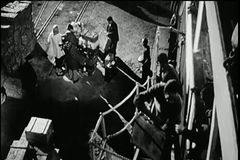 High angle view men loading luggage on ship stock video footage