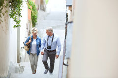 High angle view of middle-aged couple holding hands while climbing steps outdoors Royalty Free Stock Photography