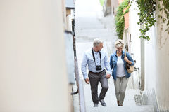 High angle view of middle-aged couple holding hands while climbing steps outdoors royalty free stock photos