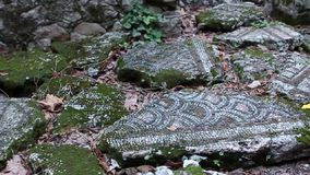 High angle view of mosaic sidewalk and broken columns in Olympos Turkey stock footage