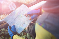 High angle view of mountain biker looking at map Stock Images
