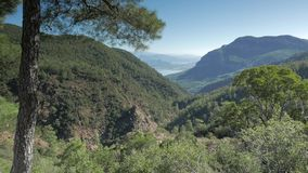 High angle view of mountain ridge overlooking sea stock video