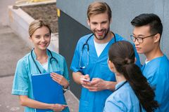 High angle view of multicultural medical students standing. Near medical university royalty free stock photo