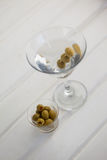 High angle view of olives in container by vodka martini. On table Royalty Free Stock Images