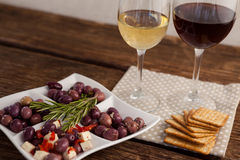 High angle view of olives served with wine. High angle view olives served with wine on table Royalty Free Stock Photo