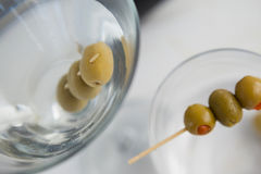 High angle view of olives in vodka martini. On table Stock Images