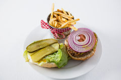 High angle view of open burger by French fries. In container on plate Stock Images