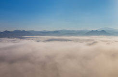 High angle view over tropical mountains with white fog in early morning Royalty Free Stock Photos